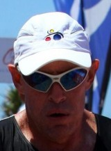 Head shot of author wearing white cap and sporty white sunglasses.