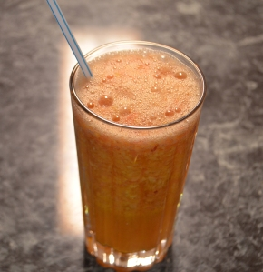 a yellow-orange colored smoothie